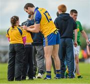 18 May 2014; Senan Kilbride, Roscommon, signs autographs for children after the game. Connacht GAA Football Senior Championship Quarter-Final, Roscommon v Leitrim, Dr. Hyde Park, Roscommon. Picture credit: Piaras Ó Mídheach / SPORTSFILE
