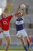 29 April 2006; Craig Rogers, Laois, in action against Paul Kerrigan, Cork. Cadbury's U21 Football Semi-final Replay. Laois v Cork, Gaelic Grounds, Limerick. Picture credit: Kieran Clancy / SPORTSFILE
