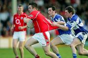 29 April 2006; Paul Kerrigan, Cork, in action against Craig Rogers and Cathal Ryan, Laois. Cadbury's U21 Football Semi-final Replay. Laois v Cork, Gaelic Grounds, Limerick. Picture credit: Kieran Clancy / SPORTSFILE