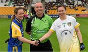 3 May 2014; Referee Colm McManus with captains Feena Beirne, left, Roscommon, and Áine Tubridy, Antrim, before the game. TESCO Ladies National Football League Division 4 Final, Antrim v Roscommon, O'Connor Park, Tullamore, Co. Offaly. Picture credit: Ray McManus / SPORTSFILE