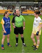 3 May 2014; Referee Colm McManus perfoms the pre-match coin toss with captains Feena Beirne, left, Roscommon, and Áine Tubridy, Antrim. TESCO Ladies National Football League Division 4 Final, Antrim v Roscommon, O'Connor Park, Tullamore, Co. Offaly. Picture credit: Ray McManus / SPORTSFILE