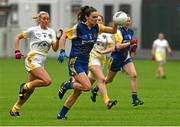 3 May 2014; Sinéad Kenny, Roscommon, in action against Áine Tubridy, Antrim. TESCO Ladies National Football League Division 4 Final, Antrim v Roscommon, O'Connor Park, Tullamore, Co. Offaly. Picture credit: Ray McManus / SPORTSFILE