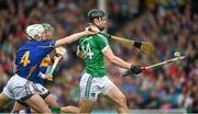 1 June 2014; Kevin Downes, Limerick, in action against Michael Cahill, Tipperary. Munster GAA Hurling Senior Championship, Semi-Final, Tipperary v Limerick, Semple Stadium, Thurles, Co. Tipperary. Picture credit: Ray McManus / SPORTSFILE