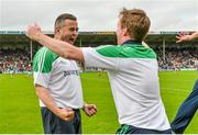 1 June 2014; Limerick manager TJ Ryan and selector Paul Beary celebrate at the final whistle. Munster GAA Hurling Senior Championship, Semi-Final, Tipperary v Limerick, Semple Stadium, Thurles, Co. Tipperary. Picture credit: Diarmuid Greene / SPORTSFILE