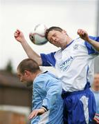 14 May 2006; John Hogan, Blarney United, is tackled by Eoin O'Driscoll, Avondale United. FAI Carlsberg Intermediate Cup Final, Blarney United v Avondale United, Turners Cross, Cork. Picture credit; Kieran Clancy / SPORTSFILE