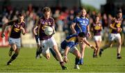 7 June 2014; Kevin O'Grady, Wexford, in action against Shane Mulligan, Longford. Leinster GAA Football Senior Championship, Quarter-Final, Longford v Wexford, Glennon Brothers Pearse Park, Longford. Picture credit: Oliver McVeigh / SPORTSFILE