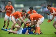 8 June 2014; Jack Brady, Cavan, surrounded by Brendan Donaghy, Stefan Campbell, Ciaran McKeever and Kieran Toner, Armagh. Ulster GAA Football Senior Championship, Quarter-Final, Armagh v Cavan, Athletic Grounds, Armagh. Picture credit: Oliver McVeigh / SPORTSFILE