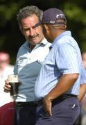 4 June 2006; Sam Torrance, Scotland, in conversation with Jerry Bruner, USA, right, while enjoying a pint of guinness after victory in the AIB Irish Seniors Open. Fota Island Golf Club, Co. Cork. Picture credit: Pat Murphy / SPORTSFILE