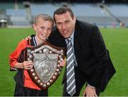 10 June 2014; Conor Baldwin a member of the victorious St Brigid'd Boys National School, Killester, Dublin, who were presented with the Marino Shield is photographed with his uncle the former Dublin star Ciaran Whelan after the game. Allianz Cumann na mBunscol Football Finals, Croke Park, Dublin. Picture credit: Ray McManus / SPORTSFILE