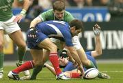 14 February 2004; Christophe Dominici of France in action against Gordon D'Arcy of Ireland during the RBS Six Nations Rugby Championship match between France and Ireland at Stade de France in Paris, France. Photo by Brendan Moran/Sportsfile