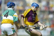 11 June 2006; Michael Jordan, Wexford, in action against David Franks, Offaly. Guinness Leinster Senior Hurling Championship, Semi-Final, Offaly v Wexford, Nowlan Park, Kilkenny. Picture credit: Aoife Rice / SPORTSFILE