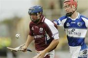 17 June 2006; Damien Hayes, Galway, in action against Brian Campion, Laois. Guinness All-Ireland Senior Hurling Championship Qualifier, Round 1, Laois v Galway, O'Moore Park, Portlaoise, Co. Laois. Picture credit: Brian Lawless / SPORTSFILE