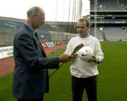19 September 2003; DJ Carey gives Jack Charlton instructions on how to hold a hurley as the three legends of Irish sport, DJ Carey, Tony Ward and Jack Charlton came together in Croke Park, Dublin, for a Flora pro.active cholesterol awareness campaign to mark World Heart Day, which is Sunday 28 September 2003. Picture credit; Ray McManus / SPORTSFILE
