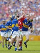 25 June 2006; Jerry O'Connor, Cork, in action against Paul Kelly, left, and Ger O'Grady, Tipperary. Guinness Munster Senior Hurling Championship Final, Tipperary v Cork, Semple Stadium, Thurles, Co. Tipperary. Picture credit: Brendan Moran / SPORTSFILE