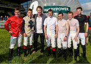 27 June 2014: Jockeys, from left, Gary Carroll, Leigh Roche, Pat Smullen, Wayne Lordan, Billy Lee and Joseph O'Brien with Hector O hEochagain after the Paddy Power Zorb Derby in aid of the Jack and Jill Children's Foundation. Curragh Racecourse, The Curragh, Co. Kildare. Picture credit: Barry Cregg / SPORTSFILE