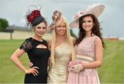 28 June 2014: Enjoying a day at the races are, from left, Niamh McMahon, from Drumconrath, Co. Meath, Shannen Reilly-McGrath, from Tallaght, Dublin, and Fionnuala Short, from Dundalk, Co. Louth. 2014 Dubai Duty Free Irish Derby Festival, Curragh Racecourse, The Curragh, Co. Kildare. Picture credit: Barry Cregg / SPORTSFILE
