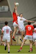 28 June 2014; Paddy Keenan, Louth, in action against Colm Cavanagh, Tyrone. GAA Football All Ireland Senior Championship, Round 1B, Tyrone v Louth, Healy Park, Omagh, Co. Tyrone. Picture credit: Oliver McVeigh / SPORTSFILE