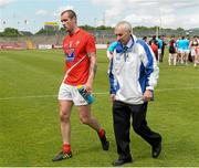 28 June 2014; A dejected Paddy Keenan, Louth, leaves the field after the game. GAA Football All Ireland Senior Championship, Round 1B, Tyrone v Louth, Healy Park, Omagh, Co. Tyrone. Picture credit: Oliver McVeigh / SPORTSFILE
