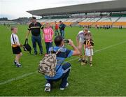 28 June 2014; Kilkenny supporter Evan Coogan, age 5, from Ballyragget, Co. Kilkenny, has a photograph taken by his father Pat, with Kilkenny's Henry Shefflin after the game. Leinster GAA Hurling Senior Championship, Semi-Final Replay, Kilkenny v Galway, O'Connor Park, Tullamore, Co. Offaly. Picture credit: Ray McManus / SPORTSFILE