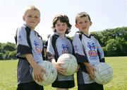 13 July 2006; Andrew McMahon, Ciara Barry and Jason Gillane at the Limerick Cul Camp. The GAA Vhi Cul Camps have been extremely popular to date and are expected to attract a record 75,000 children over the summer months. The camps run through until August 25th. Patrickswell GAA Grounds, Patrickswell, Co. Limerick. Picture credit: Kieran Clancy / SPORTSFILE