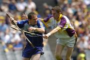 23 July 2006; David Fitzgerald, Clare, in action against Stephen Doyle, Wexford. Guinness All-Ireland Senior Hurling Championship Quarter-Final, Clare v Wexford, Croke Park, Dublin. Picture credit: Aoife Rice / SPORTSFILE