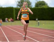 5 July 2014; Marie O'Halloran, Leevale AC, crosses the finish line to win the Girl's U18 4x100m final event. GloHealth AAI Juvenile Track and Field Relay Championships, Tullamore, Co. Offaly. Picture credit: Pat Murphy / SPORTSFILE