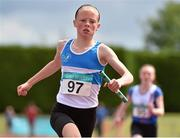 5 July 2014; Corrine Kenny, St. Laurence O'Toole AC, crosses the finish line to win the Girl's U14 4x100m final event. GloHealth AAI Juvenile Track and Field Relay Championships, Tullamore, Co. Offaly. Picture credit: Pat Murphy / SPORTSFILE