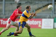 25 July 2006; Dara Blake, Clare, is tackled by Paddy Keenan, Louth. Tommy Murphy Cup, Round 1, Clare v Louth, Cusack Park, Ennis, Co. Clare. Picture credit: Kieran Clancy / SPORTSFILE