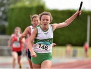 5 July 2014; Chloe Tobin, Emerald AC, crosses the finish line to win the Girl's U16 4x100m final event. GloHealth AAI Juvenile Track and Field Relay Championships, Tullamore, Co. Offaly. Picture credit: Pat Murphy / SPORTSFILE