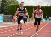 5 July 2014; David McDonald, Menapians AC, crosses the finish line to win the Boy's U16 4x100m final event. GloHealth AAI Juvenile Track and Field Relay Championships, Tullamore, Co. Offaly. Picture credit: Pat Murphy / SPORTSFILE