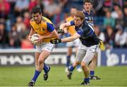 5 July 2014; Francis McGee, Longford, in action against Brian Fox, Tipperary. GAA Football All Ireland Senior Championship, Round 2A, Tipperary v Longford. Semple Stadium, Thurles, Co. Tipperary. Picture credit: Stephen McCarthy / SPORTSFILE