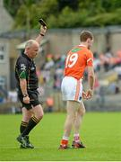 6 July 2014; Finnian Moriarty, Armagh, leaves the field after being shown a black card by referee Marty Duffy. Ulster GAA Football Senior Championship, Semi-Final Replay, Armagh v Monaghan, St Tiernach's Park, Clones, Co. Monaghan. Picture credit: Piaras Ó Mídheach / SPORTSFILE