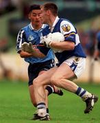 18th July 1999; Eamonn Delaney of Laois in action against Jason Sherlock of Dublin during the Bank of Ireland Leinster Football Championship Semi Final Replay between Dublin and Laois at Croke Park in Dublin. Photo by Damien Eagers/Sportsfile