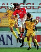 14 July 1999; Ian Gilzean of St Patricks Athletic in action against Valeriu Catinsus, left, and Kostyantyn Kulyk of FSC Zimbru during the UEFA Champions League Qualifying match between St Patricks Athletic and FSC Zimbru at Richmond Park in Dublin. Photo by Brendan Moran/Sportsfile