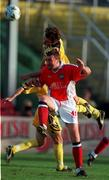 14 July 1999; Ian Gilzean of St Patricks Athletic in action against Valeriu Catinsus of FSC Zimbru during the UEFA Champions League Qualifying match between St Patricks Athletic and FSC Zimbru at Richmond Park in Dublin. Photo by Brendan Moran/Sportsfile