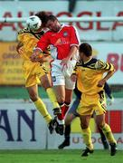 14 July 1999; Ian Gilzean of St Patricks Athletic in action against Valeriu Catinsus, left, and Kostyantyn Kulyk, FSC Zimbru during the UEFA Champions League Qualifying match between St Patricks Athletic and FSC Zimbru at Richmond Park in Dublin. Photo by Brendan Moran/Sportsfile