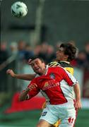 14 July 1999;  Ian Gilzean of St Patrick's Athletic in action against Valeriu Catinsus of FC Zimbru during the UEFA Champions League Qualifying match between St Patricks Athletic and FSC Zimbru at Richmond Park in Dublin. Photo by David Maher/Sportsfile