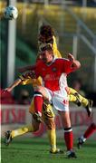14 July 1999;  Ian Gilzean of St Patrick's Athletic in action against Valeriu Catinsusu of FSC Zimbru during the UEFA Champions League Qualifying match between St Patricks Athletic and FSC Zimbru at Richmond Park in Dublin. Photo by David Maher/Sportsfile