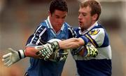 18th July 1999; Enda Sheehy of Dublin is tackled by Patrick Conway of Laois during the Bank of Ireland Leinster Football Championship Semi Final Replay between Dublin and Laois at Croke Park in Dublin. Photo by Damien Eagers/Sportsfile