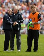 6 July 2014; Armagh manager Paul Grimley, centre, with members of the backroom team Peter McDonnell, left, and Kieran McGeeney. Ulster GAA Football Senior Championship, Semi-Final Replay, Armagh v Monaghan, St Tiernach's Park, Clones, Co. Monaghan. Picture credit: Piaras Ó Mídheach / SPORTSFILE