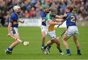 12 July 2014; Shane Dooley, Offaly, in action against Tipperary players, from left, Brendan Maher, James Woodlock, and Paddy Stapleton. GAA Hurling All-Ireland Senior Championship Round 2, Tipperary v Offaly. O'Moore Park, Portlaoise, Co. Laois. Picture credit: Piaras Ó Mídheach / SPORTSFILE