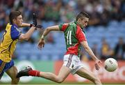 13 July 2014; Cian Hanley, Mayo, breaks through a challenge from Brian Stack, Roscommon, to score his side's first goal. Electric Ireland Connacht GAA Football Minor Championship Final, Mayo v Roscommon, Elverys MacHale Park, Castlebar, Co. Mayo. Picture credit: David Maher / SPORTSFILE