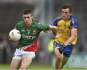 13 July 2014; Cian Hanley, Mayo, in action against Brian Stack, Roscommon. Electric Ireland Connacht GAA Football Minor Championship Final, Mayo v Roscommon, Elverys MacHale Park, Castlebar, Co. Mayo. Picture credit: David Maher / SPORTSFILE