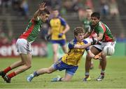 13 July 2014; Eoin Fallon, Roscommon, in action against Cian Hanley, left and Sharoize Akram, Mayo. Electric Ireland Connacht GAA Football Minor Championship Final, Mayo v Roscommon, Elverys MacHale Park, Castlebar, Co. Mayo. Picture credit: David Maher / SPORTSFILE