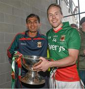 13 July 2014; Mayo captain Andy Moran, celebrate's at the end of the game with the Nestor Cup with Mayo minor player and club colleague Sharoize Akram. Connacht GAA Football Senior Championship Final, Mayo v Galway, Elverys MacHale Park, Castlebar, Co. Mayo. Picture credit: David Maher / SPORTSFILE