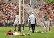 13 July 2014; Lee Keegan, Mayo runs into the Galway net after scoring a goal against goalkeeper Manus Breathnach and Donal O'Neill. Connacht GAA Football Senior Championship Final, Mayo v Galway, Elverys MacHale Park, Castlebar, Co. Mayo. Picture credit: Ray Ryan / SPORTSFILE