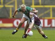 19 August 2006; Caitriona Cormican, Galway, in action against Mary Sheridan, Meath. TG4 Ladies All-Ireland Senior Football Championship Quarter-Final, Galway v Meath, O'Moore Park, Portlaoise, Co. Laois. Picture credit: Brendan Moran / SPORTSFILE