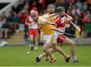 13 July 2014; PJ O'Connell, Antrim, in action against Conor Quinn, Derry. Ulster GAA Hurling Senior Championship Final, Antrim v Derry, Owenbeg, Derry. Picture credit: Oliver McVeigh / SPORTSFILE