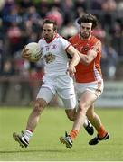 13 July 2014; Mark Donnelly, Tyrone, in action against Aaron Findon, Armagh. GAA Football All-Ireland Senior Championship Round 2B, Tyrone v Armagh, Healy Park, Omagh, Co. Tyrone. Picture credit: Barry Cregg / SPORTSFILE