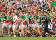 13 July 2014; Mayo Players Sharoize Akram and Mathew Flanagan hold the cup followed by their teammates. Electric Ireland Connacht GAA Football Minor Championship Final, Mayo v Roscommon, Elverys MacHale Park, Castlebar, Co. Mayo. Picture credit: Ray Ryan / SPORTSFILE